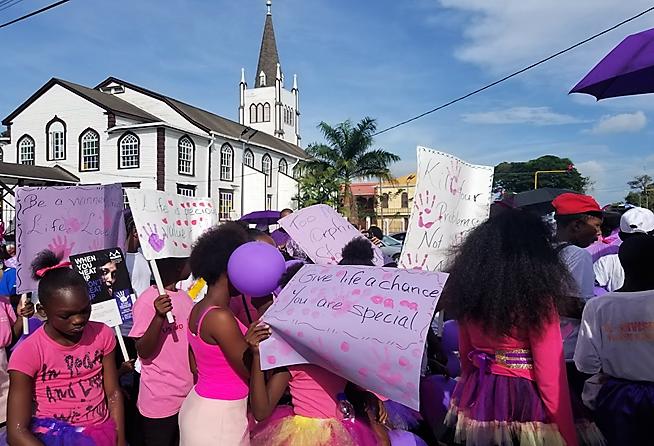 People in Georgetown, Guyana marching against violence against women