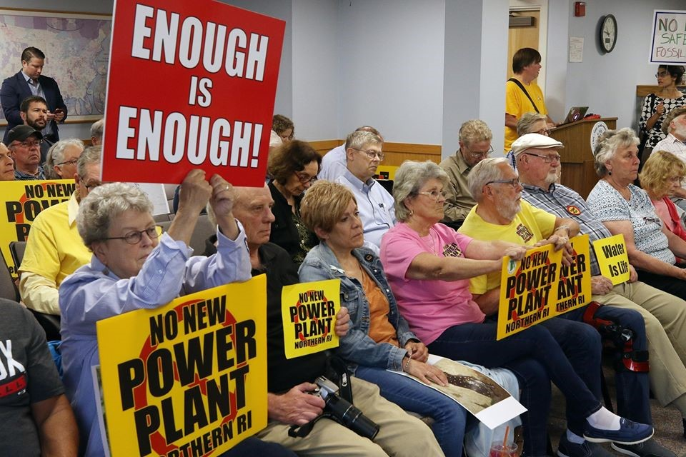 Protesters at an Energy Facility Siting Board meeting.