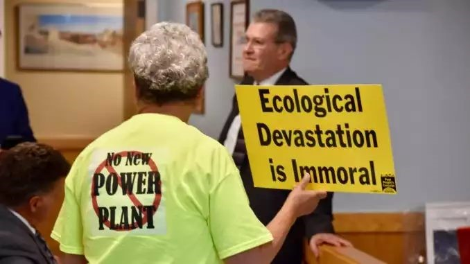 Sister Mary Pendergast protests as Michael Blazer, lawyer for Invenergy, speaks.
